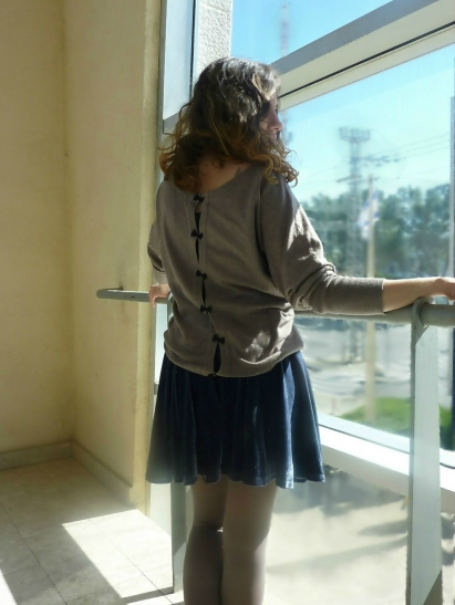 velvet skirt and bow sweater from back