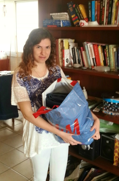Me with a bag of clothes for donation