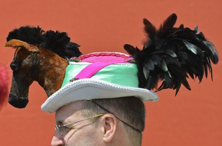 A man wearing a horse shaped hat