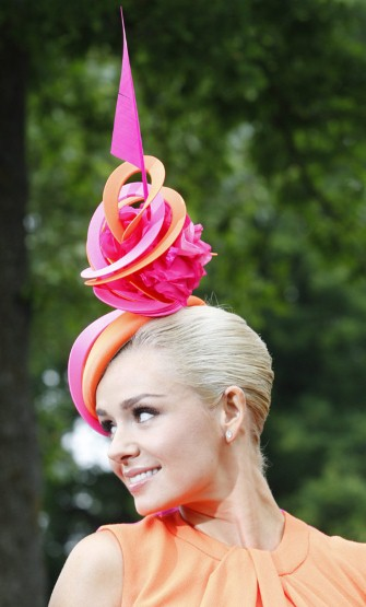 Katherine Jenkins wearing a colorful pink and orange hat